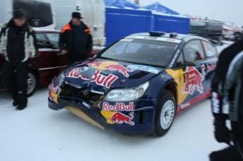 Raikkonen brings his damaged Citoen into service at the Arctic Rally