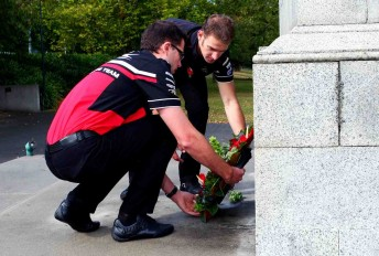 Garth Tander and Will Davison lay a wreath today