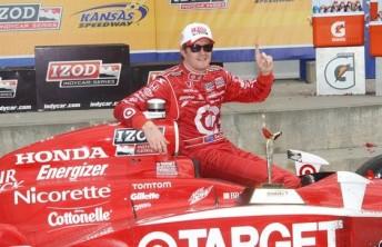 Kiwi Scott Dixon celebrates after his victory in Kansas this morning (Australian time)