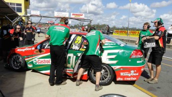 Barkley, far right, with the Castrol EDGE Commodore VE at Queensland Raceway