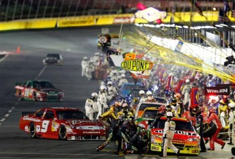 Pit road is busy during a caution period in the Bank of America 500 at Charlotte Motor Speedway