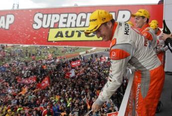 TeamVodafone drivers Mark Skaife and Craig Lowndes celebrate on the Bathurst podium