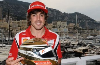 Fernando Alonso with the special helmet he'll wear in the next two Grands Prix