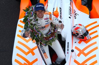 Dan Wheldon celebrates his 2011 Indianapolis 500 victory