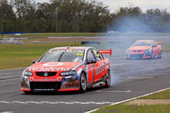 Sebastien Bourdais smokes the tyres in a practice start at Queensland Raceway today