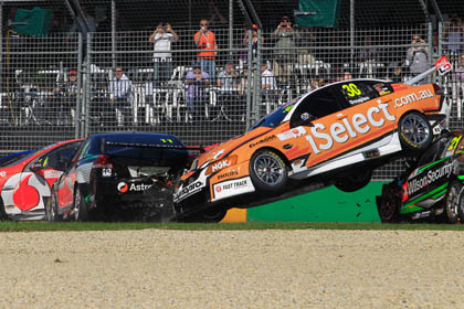 Taz Douglas is launched into the air during the big Race 3 accident