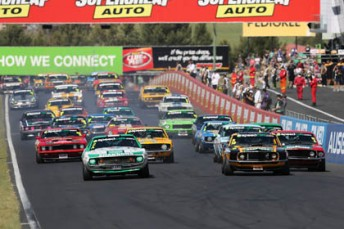 The Touring Car Masters field blasts towards Hell Corner