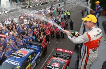 Craig Lowndes celebrates his 89th career win