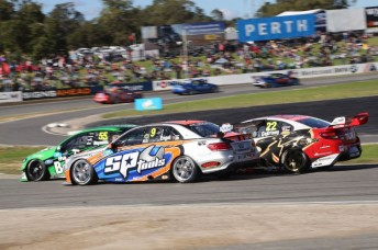 Maro Engel fights with the Ford of David Reynolds and the Holden of James Courtney