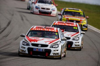 The four Walkinshaw Racing-built Commodores running line-astern at Barbagallo