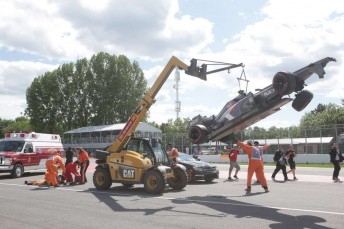 The marshal receives immediate attention after being struck by the mobile crane