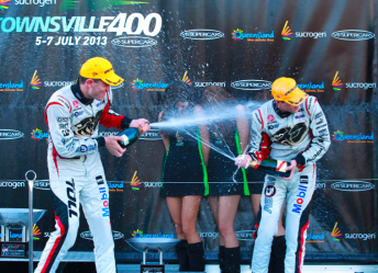 Tander and Courtney celebrate on the podium