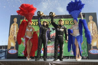 Alexis DeJoria (Left) and Tony Schumacher on the dais in Vegas