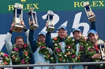 The AMR crew celebrate on the podium
