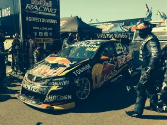 The Red Bull team rush to repair Lowndes' Holden for Race 21 later in the day