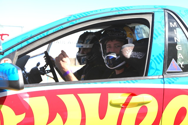 Travis Pastrana takes a ride with Matt Mingay in the Hot Wheels Ute at Queensland Raceway