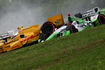 Sebastien Bourdais had a lucky escape after Ryan Hunter-Reay's machine slammed into the the Frenchman
