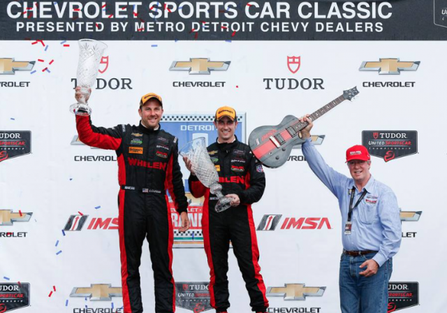Dane Cameron and Eric Curran celebrate victory at Detroit