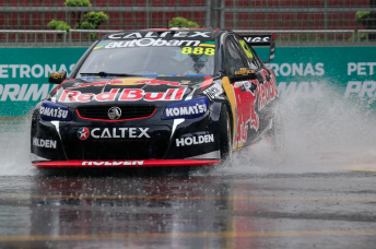 Lowndes' early laps were run in heavily wet conditions
