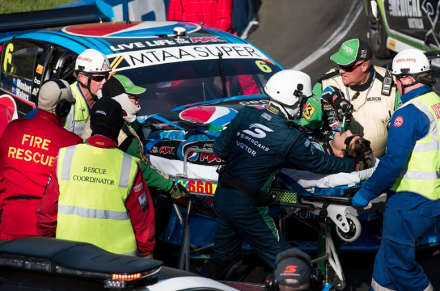 Mostert in the hands of medical crews at the crash scene