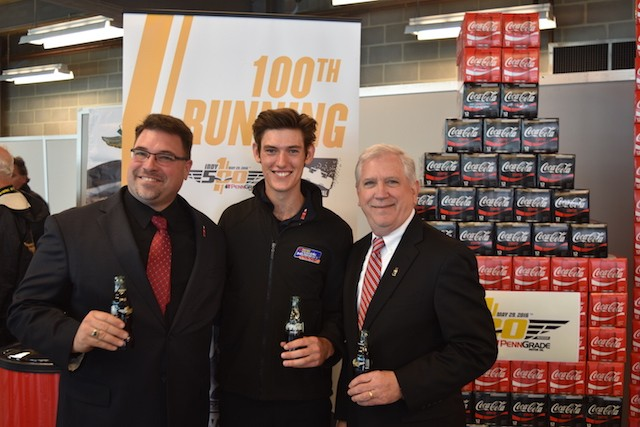 Matt Brabham flanked by Coca-Cola's Todd Marty (left) and Roy Potts