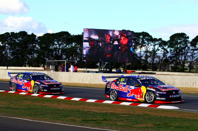 The Red Bull team watch on as Van Gisbergen leads Whincup