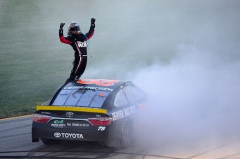 Martin Truex jr celebrates after taking the opening Chase encounter at Chicagoland
