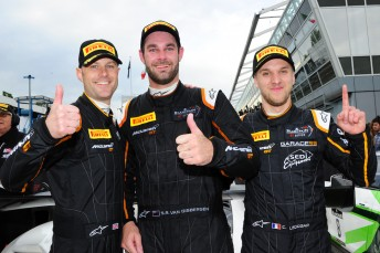 Shane van Gisbergen (centre) with McLaren co-drivers Rob Bell and Come Ledogar